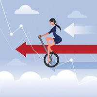 Businesswoman cycling on graph