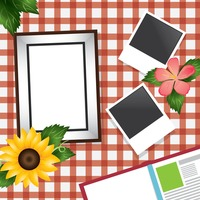 Photo frame on checkered tablecloth