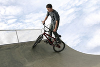 A boy cycling in a skateboard park
