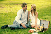 A couple picnicking in the park