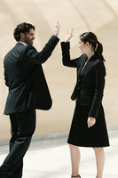 A guy giving his female colleague a high five
