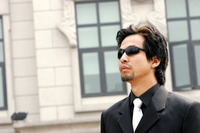 A man in business suit wearing sunglass