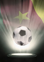A soccer ball with cameroon flag backdrop