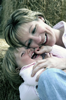 A woman laughing with her daughter