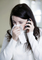 A woman with cold on the phone