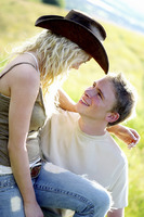 A woman with cowboy hat talking to her boyfriend