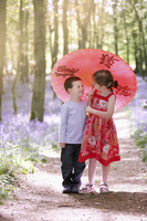Boy and girl sharing an umbrella