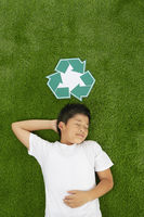 Boy lying on the grass