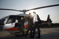 Business people boarding helicopter