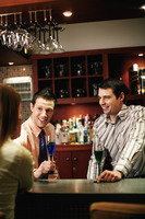 Business people drinking and chatting in the bar