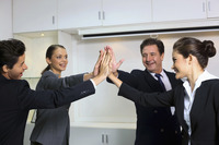Business people giving high-five at board room