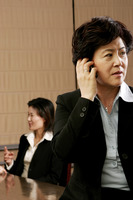 Business woman talking on the hand phone