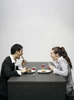 Businessman and businesswoman having dinner together
