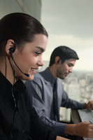 Businessman and businesswoman with telephone headsets
