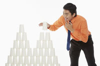 Businessman arranging disposable cups