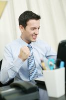 Businessman cheering and showing fist