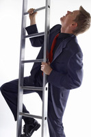 Businessman climbing up the ladder