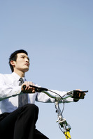Businessman cycling bicycle