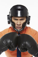 Businessman dressed with boxing gear