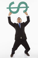 Businessman lifting up a dollar sign
