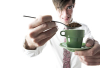 Businessman making a cup of tea
