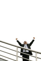 Businessman screaming while raising his hands