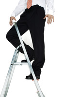 Businessman standing on top of a ladder