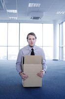 Businessman staying in a box