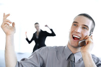Businessman talking happily on the mobile phone