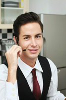 Businessman talking on telephone headset