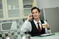 Businessman talking on the phone during tea break