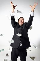 Businessman throwing money in the air