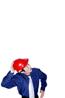 Businessman with a red safety helmet looking up