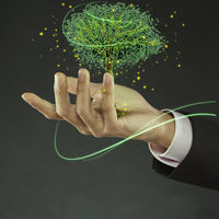Businessman with a tree on his palm