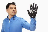 Businessman with glove showing hand gesture