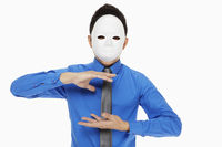 Businessman with mask showing hand gesture