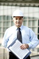 Businessman with safety helmet