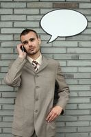 Businessman with speech bubble talking on the phone