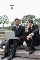 Businessmen working outdoors