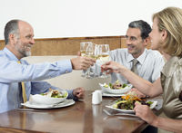 Businesspeople toasting drinks in restaurant
