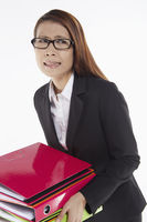 Businesswoman carrying a stack of files