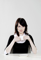 Businesswoman holding a cup of coffee