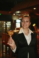Businesswoman holding a glass of cocktail