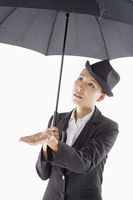 Businesswoman holding an umbrella