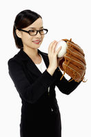 Businesswoman playing baseball