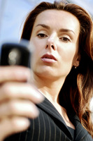Businesswoman reading messages on her mobile phone