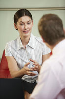 Businesswoman talking in meeting close-up
