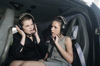 Businesswomen with headset in helicopter