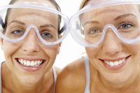 Close-up of two women with goggles looking at the camera