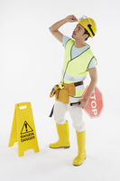 Construction worker holding a stop